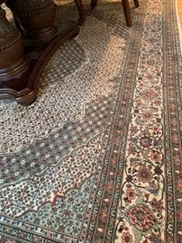 28. Hand Knotted Wool and Silk Rug (8' x 10')