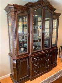 """26. Carved Lighted Breakfront w/ Mirror Back (77"""" x 20"""" x 94"""")"""
