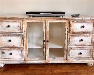 Shabby Chic: TV stand with three drawers on either side and room for components below.