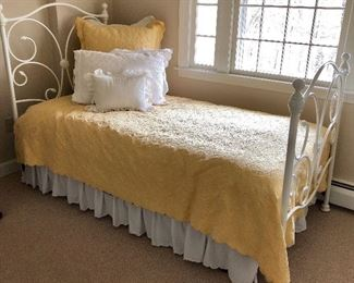 Cute white metal bed with scrolled back