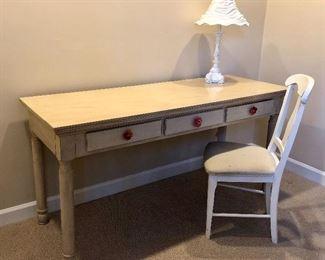Small- three drawer writing desk.