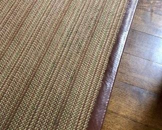 Interesting rug with leather edges