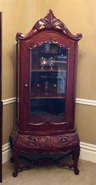 Vintage mahogany curio cabinet. Reproduction of 18th century Rococo style.