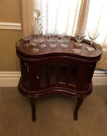 Hand carved mahogany kidney shaped end table. Removable tray. Beveled glass.