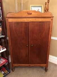 English wardrobe used for entertainment center. Birdseye maple.