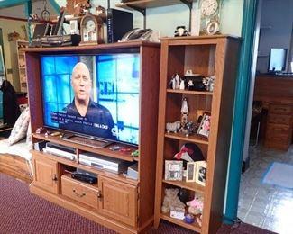 OAK STORAGE UNIT / LARGE SCREEN TV.