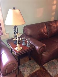 Closeup of the gorgeous leather couches.  They are actually a brown color -the sun was a bit too bright in this picture