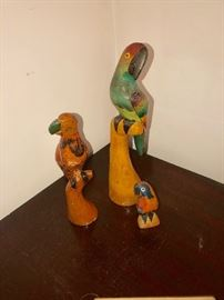 Wooden parrot statues