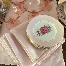 Pink vintage linens, china and glassware.