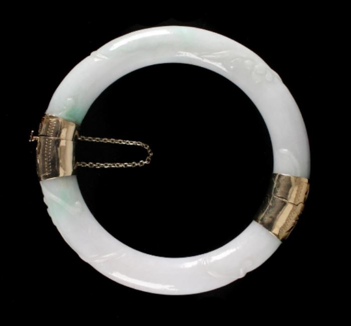 Description: Hinged yellow gold mounted marked 585. White and scattered green Jadeite.  Weight: 4 ounces.  Low Estimate: 600  High Estimate: 800  Condition: Excellent  Size: Diameter: 3 inches.  Weight: 4 ounces. Dimensions: 1 3/4 inches. Condition Report: Excellent Notes: 4 ounces.