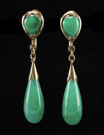 Description: Jadeite dangle earrings with 14K yellow gold mounts marked 14K. Actual weight: .17 ounces troy. Dimensions: 3 3/4 inches