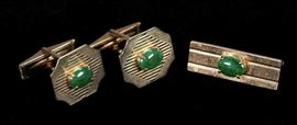 Description: Pair of 14k yellow gold cufflinks with spinach jade cabochon and matching tie clasp. All marked 14K.  Tie clasp length: 1 1/8 inches. Cufflinks: 5/8 x 1/4 inches.  Actual weight: .52 ounces troy. Dimensions: 6 3/4 inches.