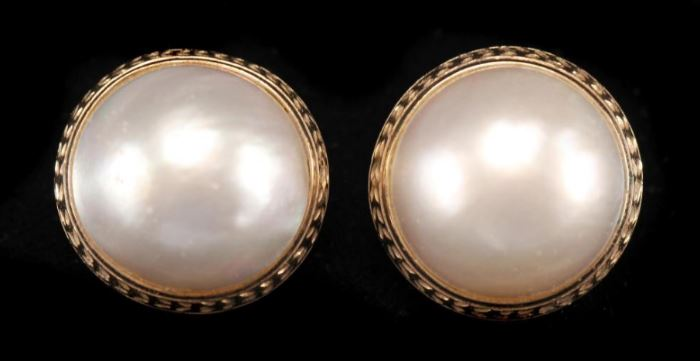 Description: Clip earrings with pearls with 14k yellow gold mounts marked 14k. Dimensions: 8 3/4 inches.