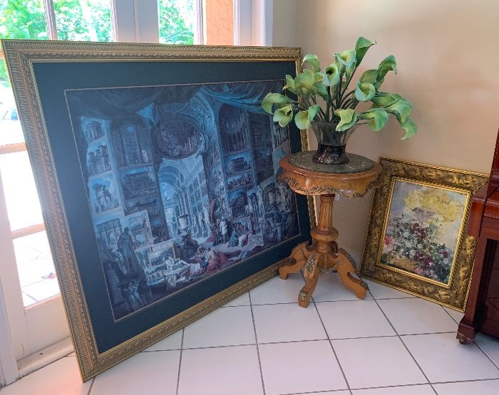 Round accent table and art to the right of table are sold.
