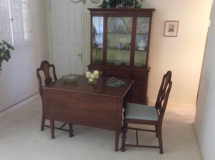 Drop leaf table and smaller china hutch