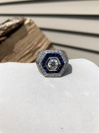 Stunning Men's 18K white gold ring, size 10, 1.18ct diamond G color in center VVS2 clarity, surrounded by 156 modern brilliant cut diamonds (2ct total weight) and 18 sapphires. With an appraisal from Champaign Jewelers for $10,550 and EGL certification papers