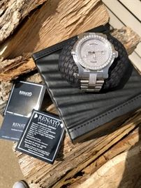 Gorgeous Men's diamond watch made by Renato. 9ct total weight, diamond tested, Swiss movement, stainless steel band