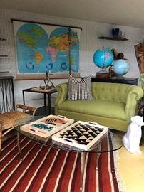 Vintage Kilim rug, industrial side tables, vintage maps and globes, dog by Royal Haeger.