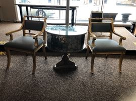 Pair of Theodore Alexander chairs with gold vein mirror table. Table swivels!