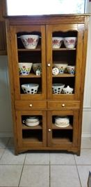 The cabinet is available but all the bowls have sold!