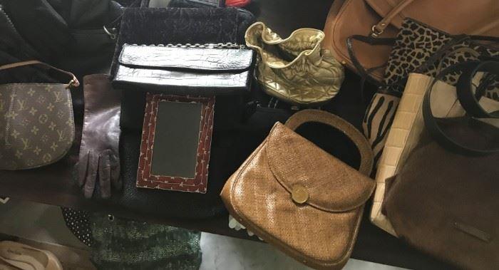 A collection of designer Purses, Clutch Bags....Louis Vuitton, Ralph Lauren, Gucci etc