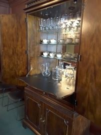Mahogany beverage cabinet by Century. Has glass shelves and mirrored interior