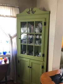 Pretty wood green corner hutch