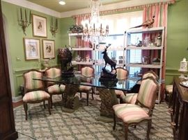 Nice Lily Pulitzer wannabe dining room! Set/8 vintage French dining chairs (2 arm, 6 sides) glass-topped dining tables, with fiberglass swan bases, pair of bronze stags, signed J. (Jules) Moigniez, framed botanicals, several sets of china, vintage Stark wool rug.