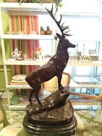 One of a pair of bronze stags, signed J. Moigniez.
