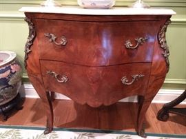Close-up of the 2-drawer French bombe chest, with bronze mounts and marble top.