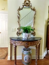 Medium, hand carved antique French gilt wood wall mirror, with one of a pair of antique gilt wood demilune tables, with green marble top.