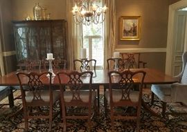 10 Ribbon back chairs 2 upholstered chairs, Table with leaves and pads, Lovely china cabinet