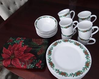 Christmas dinnerware set with matching placemats. Many Christmas pieces to choose from,  both serve-ware,  and dinnerware