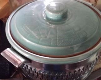 Unusual stoneware with metal serving rack