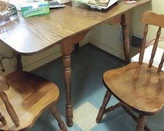 Wood Breakfast table with two chairs. Laminate top drops  for tight quarters and ease of use