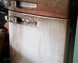 Refrigerator / freezer from 60 years ago, working today, with in garage. Also two working freezers in garage,  and a somewhat newer refrigerator upstairs!