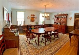 Cherry oval dining table with 2 leaves & pads along with 6 brace-back Windsor chairs by Pennsylvania House