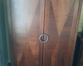 Upright wooden closet