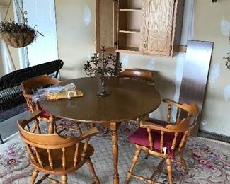 Like new oval table with two additional leaves and four matching barrel chairs