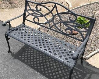 Black iron park bench