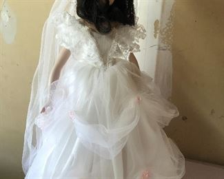 Porcelain doll in wedding gown