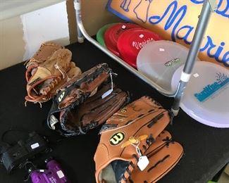 New baseball mitts, frisbees and binoculars