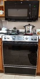 Recently purchased microwave for sale. Also the stove is for sale.