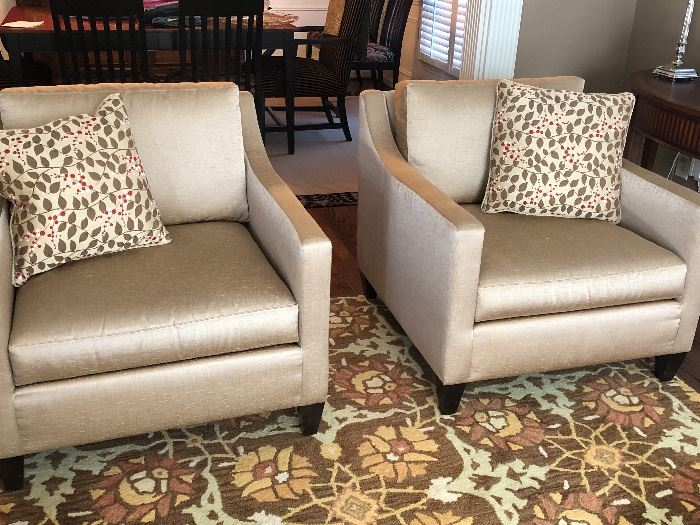 Pair of silver/gold upholstered chairs and occasional pillows