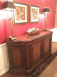 Sideboard with walnut inlay, framed prints, buffet lamps and bowl