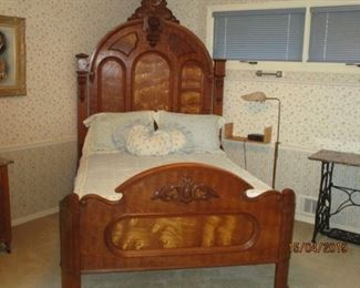 ANTIQUE CARVED VICTORIAN BED WITH A 7 1/2' (APPROX) HEADBOARD
