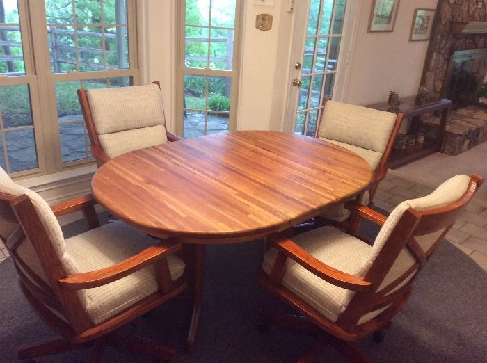 Very nice butcher block top kitchen table with one leaf and four very comfortable rolling chairs