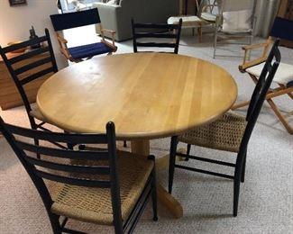 Round wood table with 5 chairs.