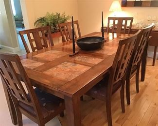 Mission style dining table with 6 chairs.  Has tile inserts on top.