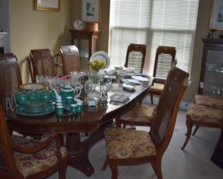Gorgeous Dining Set ( the pic does not do it justice )! Beautiful Double Pedestal Table with 10 Matching Chairs, Leaves and Custom Pad also notice how nicely the two matching Display Cabinets accentuate this Lovely Set!